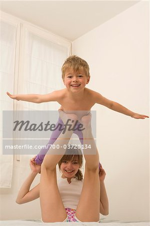 Brother and Sister Playing Airplane Stock Photo - Rights-Managed, Image code: 700-03720134