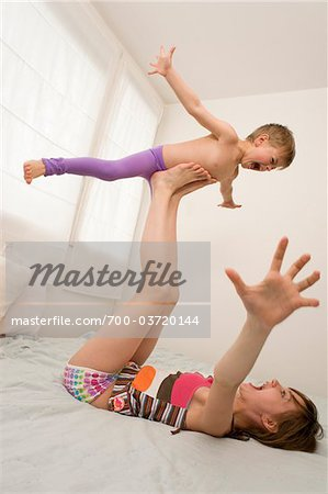 Brother and Sister Playing Airplane Stock Photo - Rights-Managed, Image code: 700-03720144
