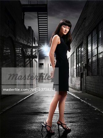 Woman in Alley at Night Stock Photo - Rights-Managed, Image code: 700-03738255