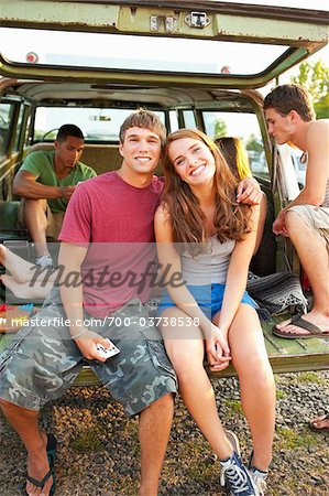 Group of Teenagers Hanging Out at Drive-In Theatre Stock Photo - Rights-Managed, Image code: 700-03738538