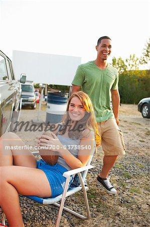 Teenagers Hanging Out at Drive-In Theater Stock Photo - Rights-Managed, Image code: 700-03738540