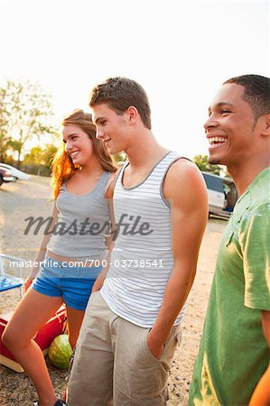 Group of Friends Hanging Out at Drive-In Theatre Stock Photo - Rights-Managed, Image code: 700-03738541