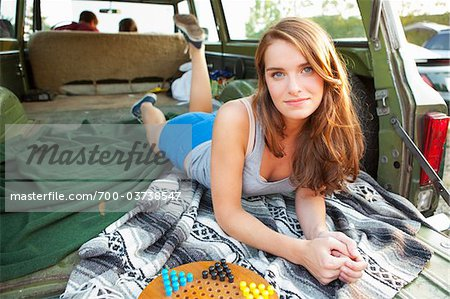 Teenage Girl Lying Down in Back of Car Stock Photo - Rights-Managed, Image code: 700-03738547
