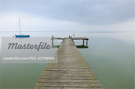 Sailboat and Dock, Lake Chiemsee, Bavaria, Germany Stock Photo - Rights-Managed, Image code: 700-03738995