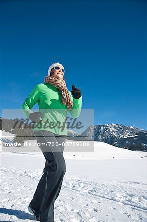 Woman Exercising Outdoors in Winter Stock Photo - Rights-Managed, Image code: 700-03739208