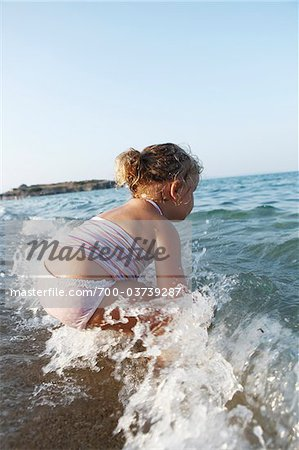 Little Girl Playing in Water at Beach Stock Photo - Rights-Managed, Image code: 700-03739287