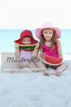 Sisters Eating Watermelon on Beach Stock Photo - Rights-Managed, Image code: 700-03739327