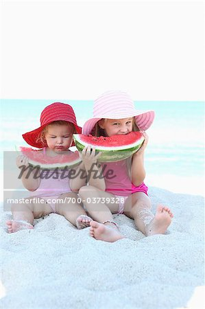 Sisters Eating Watermelon on Bridge Stock Photo - Rights-Managed, Image code: 700-03739328