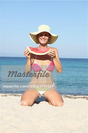 Woman with Watermelon on Beach Stock Photo - Rights-Managed, Image code: 700-03739329