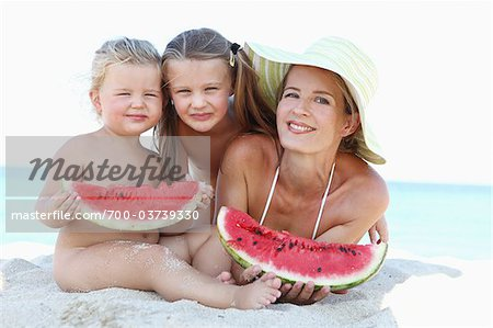 Mother and Daughters with Watermelon on Beach Stock Photo - Rights-Managed, Image code: 700-03739330