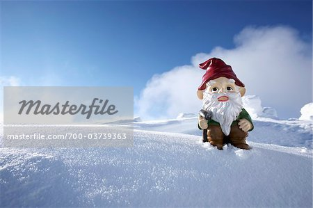 Garden Gnome on Side of Snow Covered Mountain Stock Photo - Rights-Managed, Image code: 700-03739363