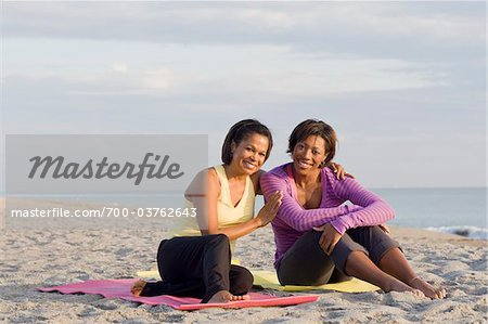 Two Women Sitting on Yoga Mats on Beach Stock Photo - Rights-Managed, Image code: 700-03762643