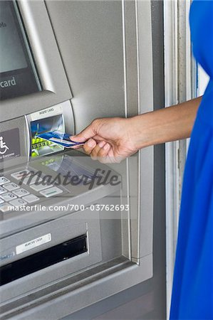 Woman Using ATM Stock Photo - Rights-Managed, Image code: 700-03762693