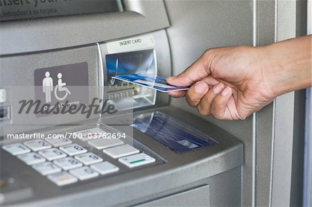 Close-Up of Woman Using ATM Stock Photo - Rights-Managed, Image code: 700-03762694