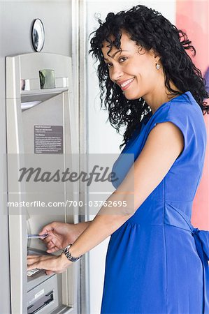 Woman Using ATM Stock Photo - Rights-Managed, Image code: 700-03762695