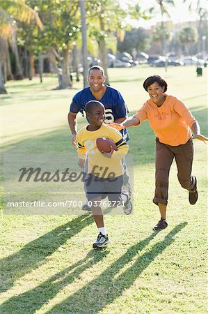 Family Playing Football Stock Photo - Rights-Managed, Image code: 700-03762721