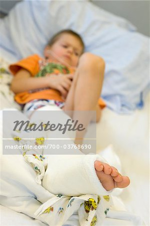 Boy Wearing Cast on Leg Stock Photo - Rights-Managed, Image code: 700-03768690