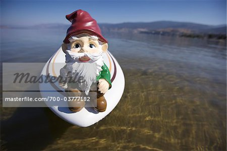 Garden Gnome on Surfboard in Lake Stock Photo - Rights-Managed, Image code: 700-03777182