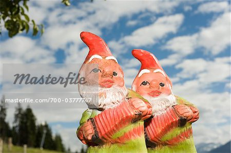 Two Garden Gnomes Against Cloudy Blue Sky Stock Photo - Rights-Managed, Image code: 700-03777747