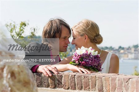 Newlywed Couple Gazing at Each Other Outdoors Stock Photo - Rights-Managed, Image code: 700-03777759
