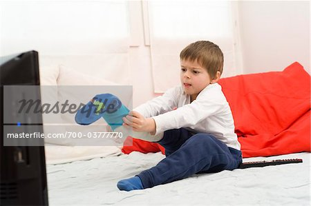 Boy with Cast on Leg Putting on Sock Stock Photo - Rights-Managed, Image code: 700-03777770