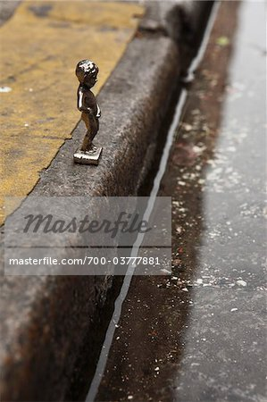 Miniature Figurine of Boy Peeing in Gutter Stock Photo - Rights-Managed, Image code: 700-03777881
