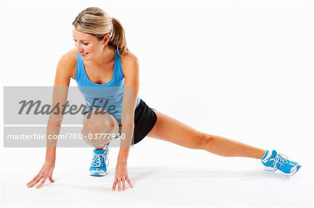 Woman Stretching in Studio Stock Photo - Rights-Managed, Image code: 700-03777930