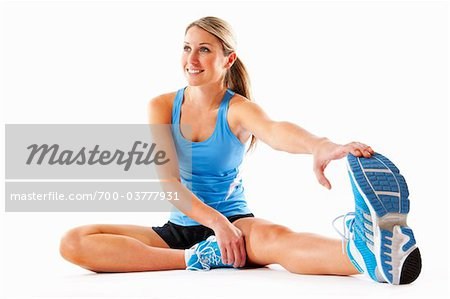 Woman Stretching in Studio Stock Photo - Rights-Managed, Image code: 700-03777931