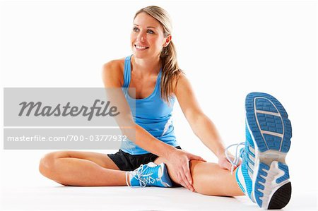 Woman Stretching in Studio Stock Photo - Rights-Managed, Image code: 700-03777932