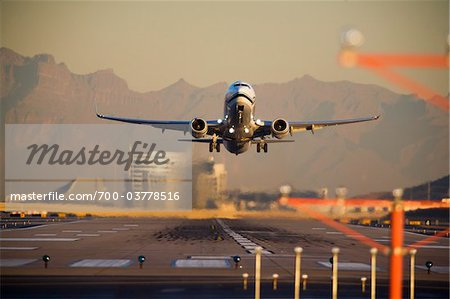 Airplane Taking Off at Sunset Stock Photo - Rights-Managed, Image code: 700-03778516