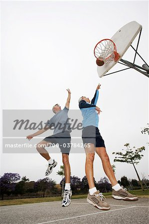 Two Men Playing Basketball Stock Photo - Rights-Managed, Image code: 700-03784265