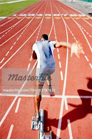 Runner Leaving Starting Block Stock Photo - Rights-Managed, Image code: 700-03787631