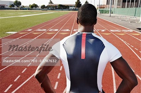 Back of Runner on Race Track Stock Photo - Rights-Managed, Image code: 700-03787632