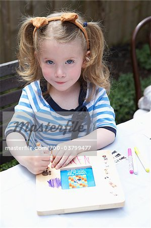 Little Girl Coloring Picture Frame Stock Photo - Rights-Managed, Image code: 700-03799477