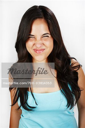 Portrait of Woman Making Face Stock Photo - Rights-Managed, Image code: 700-03814353
