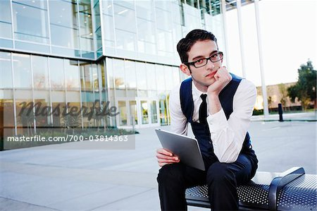 Businessman with Tablet PC Sitting on Bench Stock Photo - Rights-Managed, Image code: 700-03814363