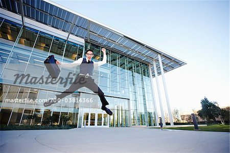 Businessman Leaping in front of Building Stock Photo - Rights-Managed, Image code: 700-03814366