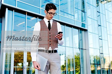 Businessman with Cell Phone and Tablet PC Stock Photo - Rights-Managed, Image code: 700-03814368