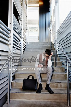 Frustrated Businessman Sitting on Stairs Stock Photo - Rights-Managed, Image code: 700-03814375