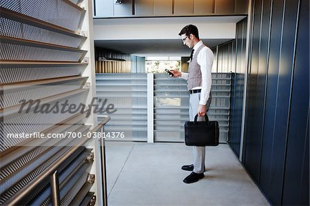 Businessman with Cell Phone Stock Photo - Rights-Managed, Image code: 700-03814376