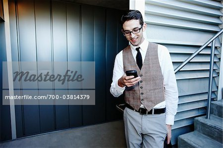 Businessman with Cell Phone Stock Photo - Rights-Managed, Image code: 700-03814379