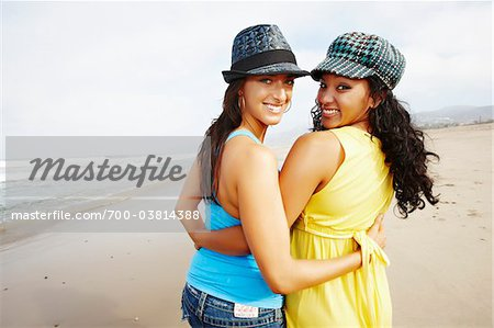 Two Friends on Beach with Arms Around Each Other Stock Photo - Rights-Managed, Image code: 700-03814388