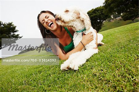 Woman Lying on Grass with Dog Stock Photo - Rights-Managed, Image code: 700-03814392