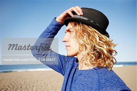 Man Wearing Hat at Beach Stock Photo - Rights-Managed, Image code: 700-03814407
