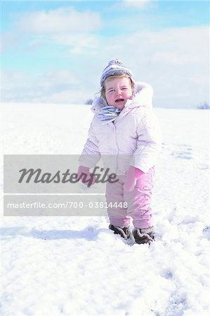 Little Girl Crying Outdoors in Winter Stock Photo - Rights-Managed, Image code: 700-03814448