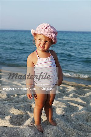Little Girl Wearing Bathing Suit on Beach Stock Photo - Rights-Managed, Image code: 700-03814456