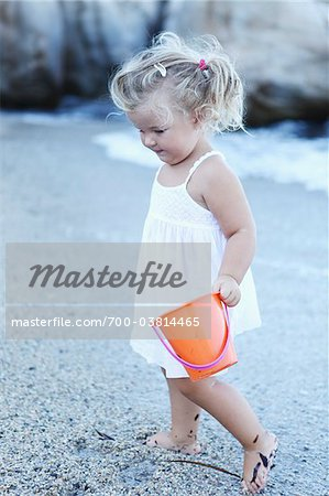 Little Girl with Bucket at Beach Stock Photo - Rights-Managed, Image code: 700-03814465