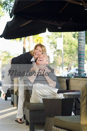 Couple Hugging at Cafe Stock Photo - Rights-Managed, Image code: 700-03814483