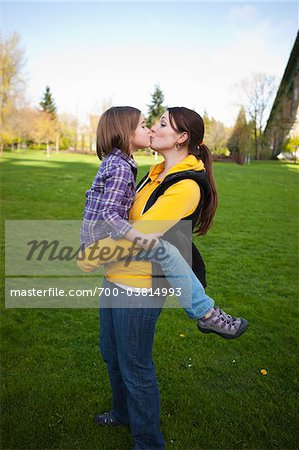 Mother and Daughter Kissing in Park Stock Photo - Rights-Managed, Image code: 700-03814993