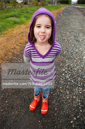 Girl Sticking Out Tongue Stock Photo - Rights-Managed, Image code: 700-03815002